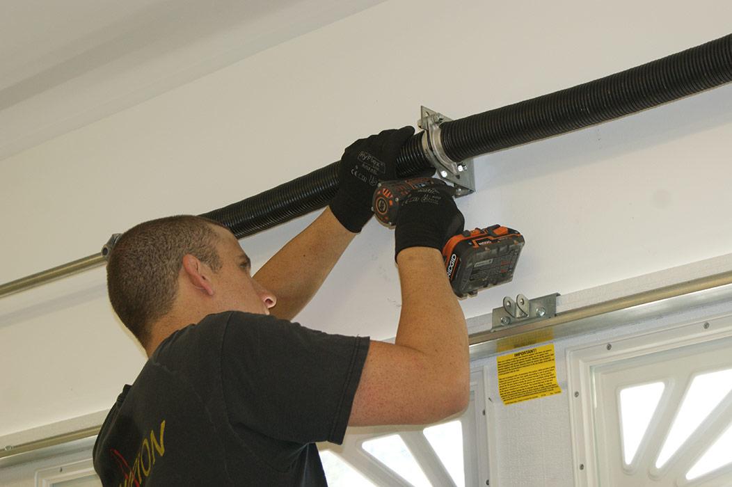 Garage door broken spring repair torsion spring repair for Garage door troubleshoot